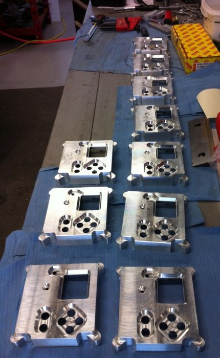 Batch of tops of Astro Pi case replicas by Tim Rowledge