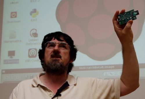 Tim Rowledge holding up a PCB