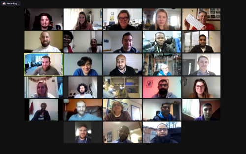 A screenshot of a video call gallery with 23 participants